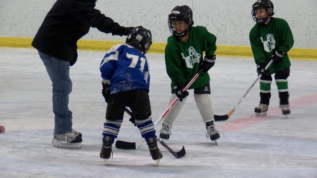 Two kids are ready for a faceoff.