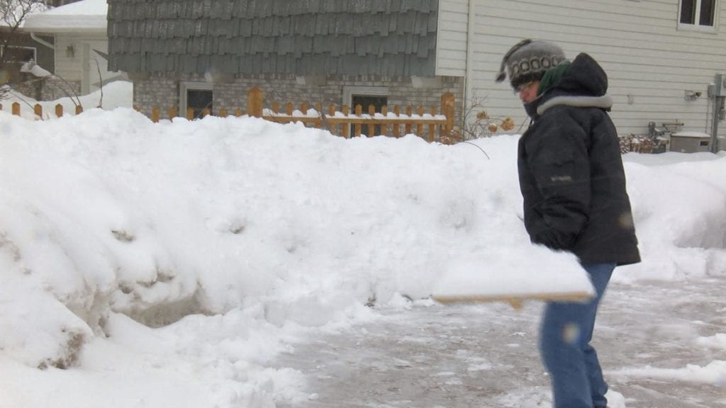 Onalaska resident Connie Olson shovels her driveway after the latest snowfall.