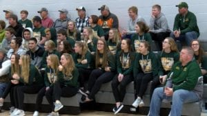 Melrose-Mindoro Girls Basketball Team sits together during an appreciation rally.