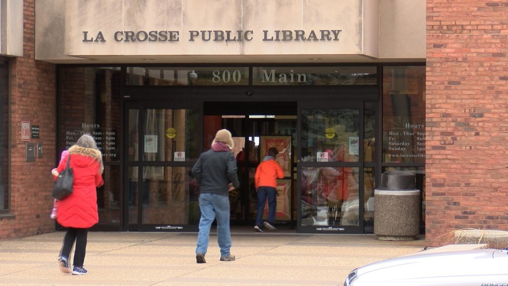 Community members enter the La Crosse Public Library