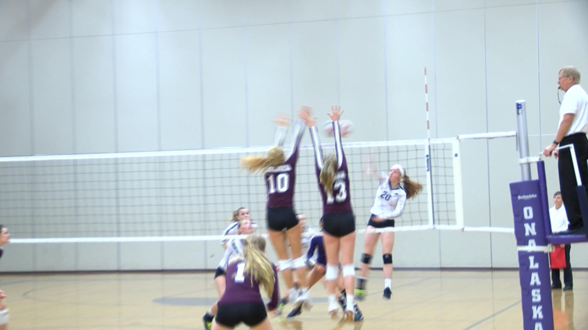 Holmen volleyball spikes Hilltoppers