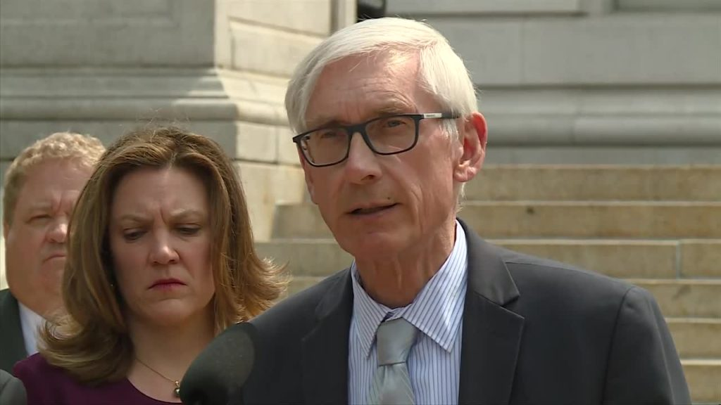Gov. Evers signs order to make electricity carbon-free by 2050