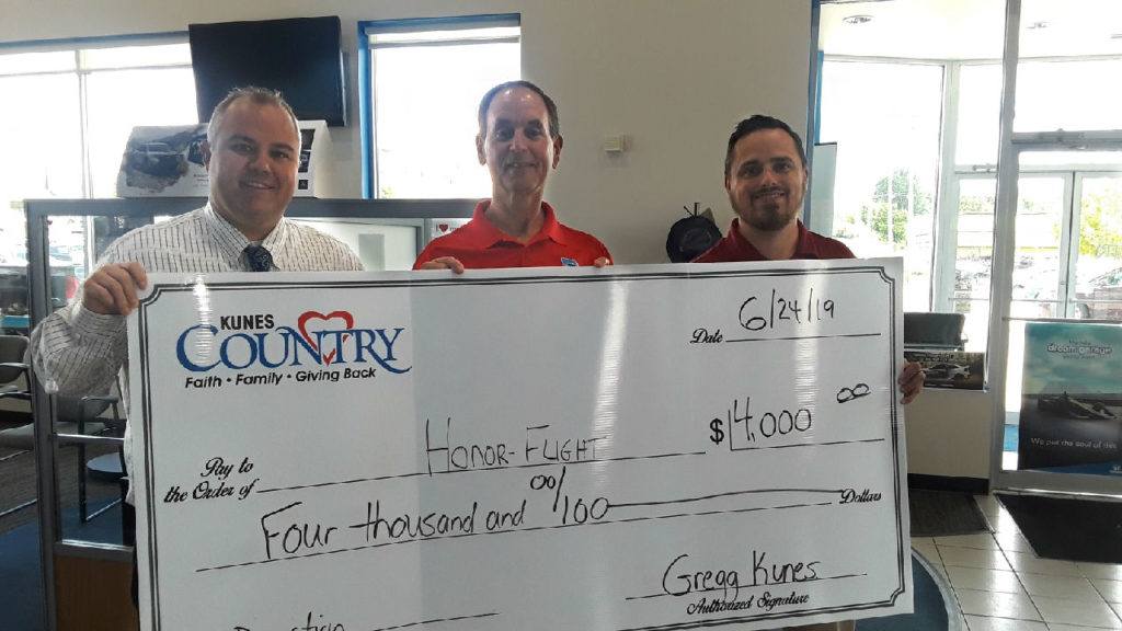 Kunes Country Dealership donates to Great River Honor Flight
