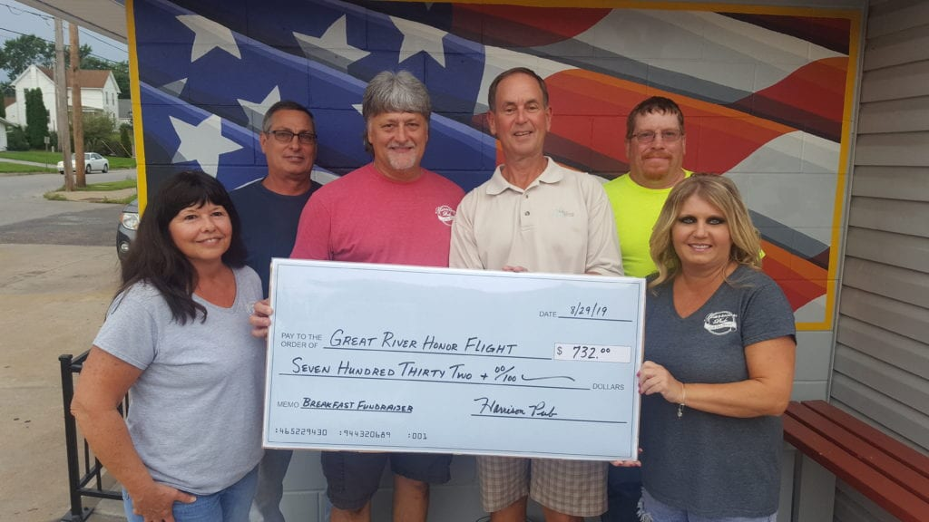 Harrison Pub presents check to Great River Honor Flight