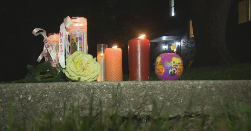 Candlelight display honors triple homicide victims killed in 2018