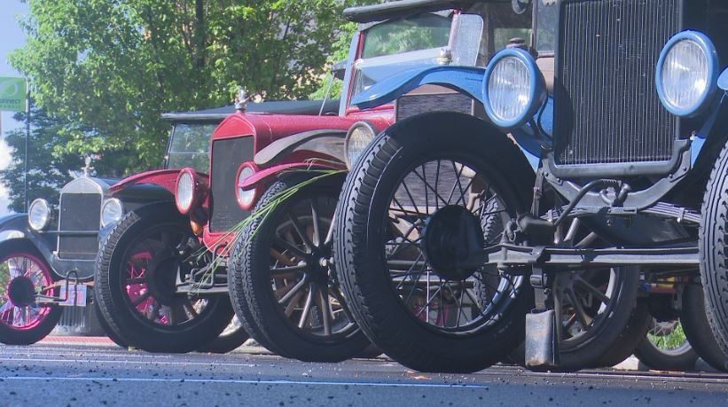 Dozens of Ford Model T's stop in downtown Bloomington
