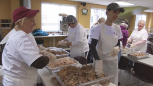 volunteers help prepare food