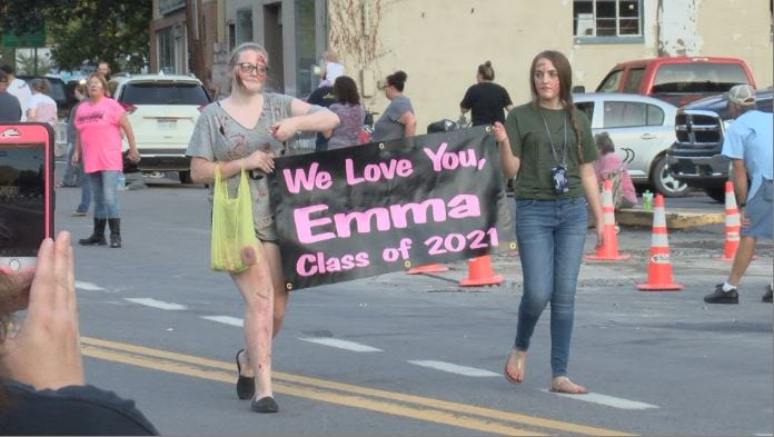 Homecoming parade honors one student unable to attend