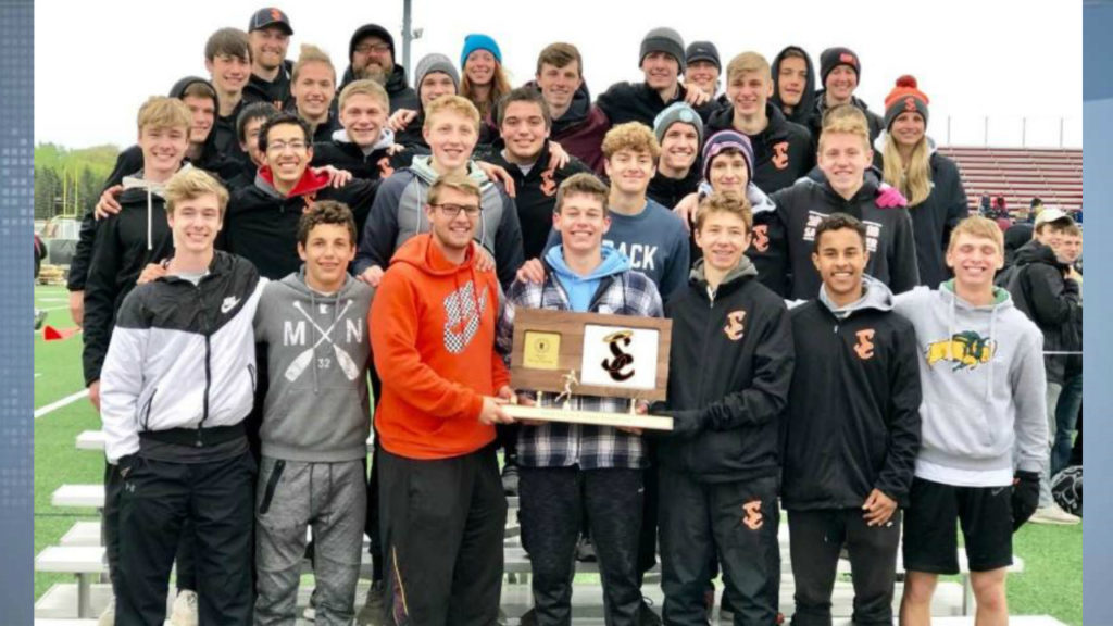 St. Charles Track team with trophy