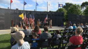 Rochester locals gather at Soldiers Field Veterans Memorial for Flag Day celebration.