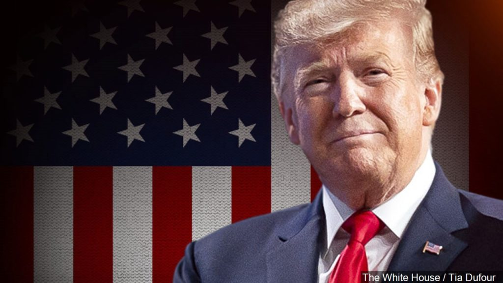 President Donald Trump with flag background