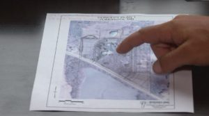 Joe Wobig pointing out townhouses on the concept plan of his development.