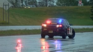 MSP squad car on I-90 in the rain
