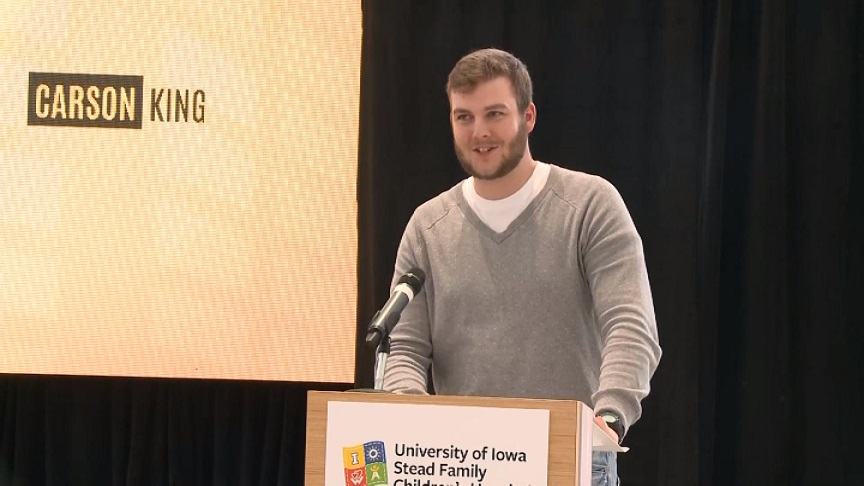 Carson King donating check to children's hospital