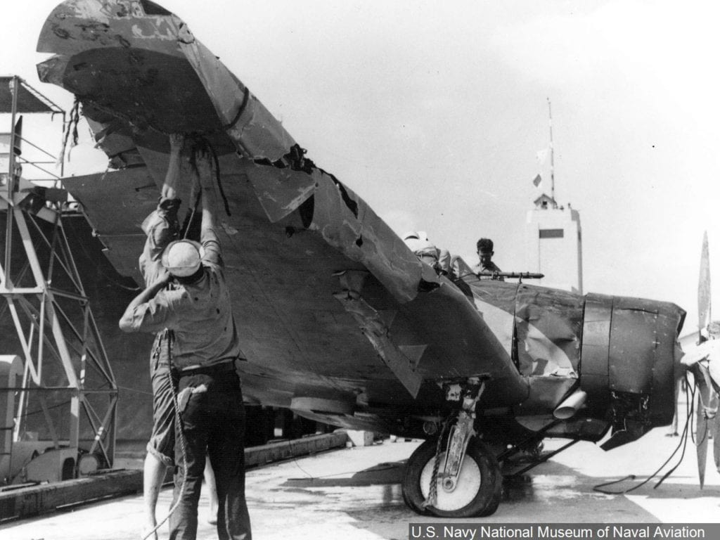 Sailors examine the wreckage of an Aichi D3A dive bomber (codenamed Val) that was salvaged from the site where it crashed during the Japanese attack on Pearl Harbor.