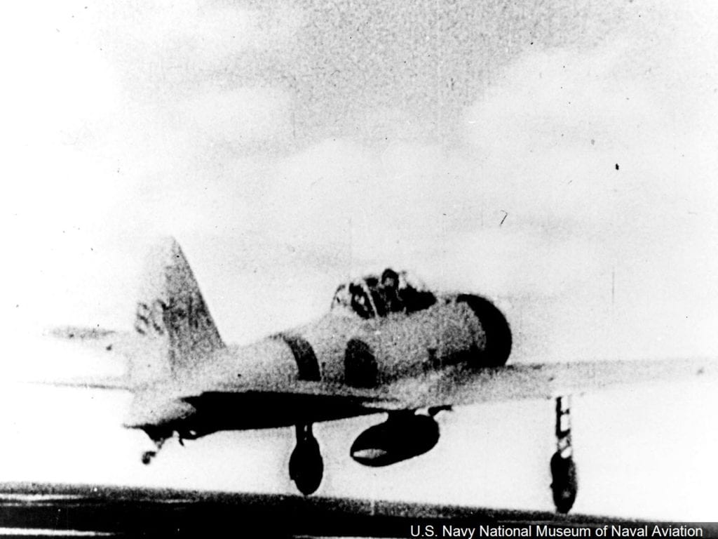 A Zero fighter roars off the deck of an Imperial Japanese Navy carrier to attack Pearl Harbor.