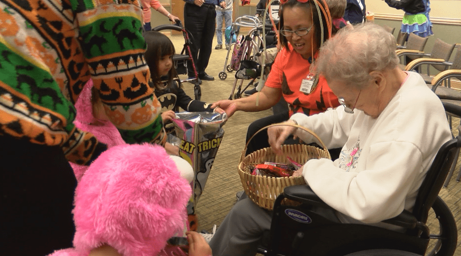 Charter House residents welcome families for Halloween party, haunted house