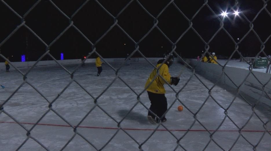 Athletes enjoy winter weather with a game of broomball