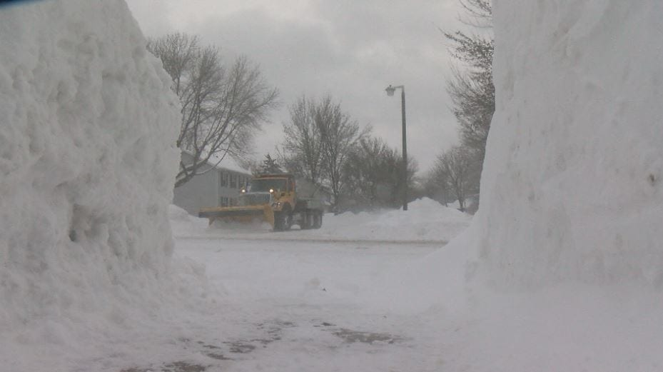 City crews dig out Rochester after record breaking snow
