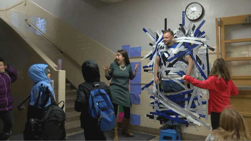 Students host fundraiser by taping principal to a wall