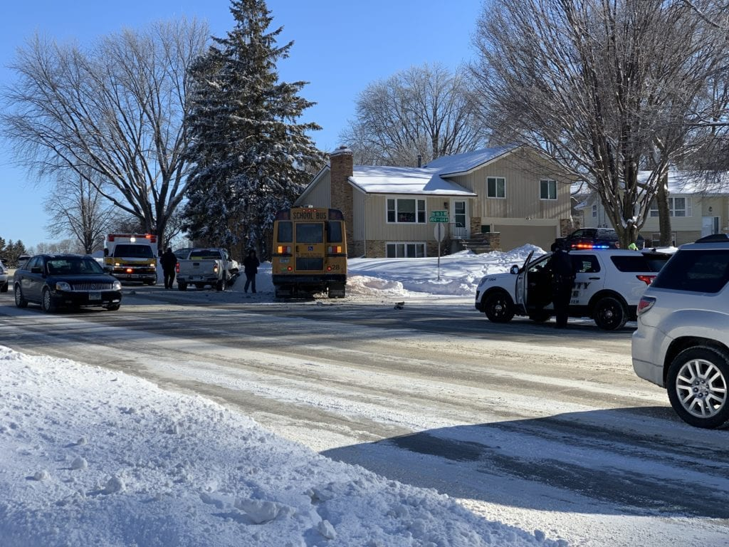 Officials respond to an accident involving a school bus and a truck