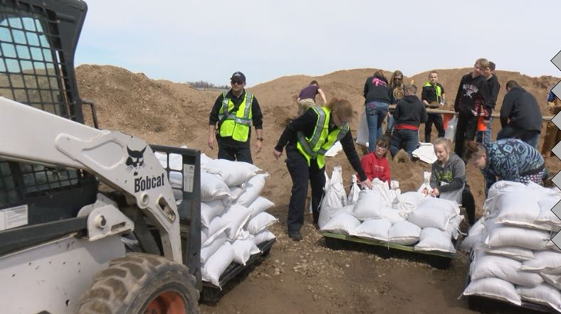 Sandbagging efforts continue in river communities