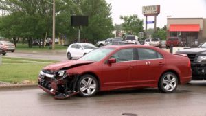 Sedan damaged in crash