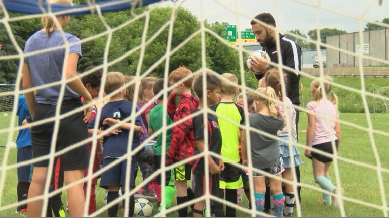 Rochester students learn soccer skills from professional coaches.