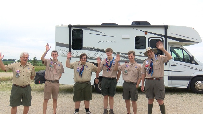Boy Scouts waving before departing for World Scout Jamboree
