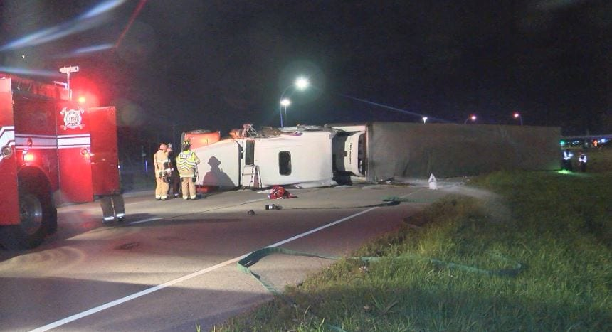 Semi hauling ice cream rolls over on Highway 63