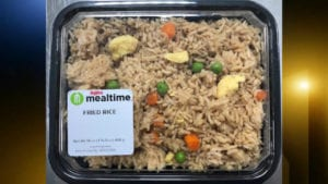 Fried rice mixed with scrambled eggs, peas and carrots.