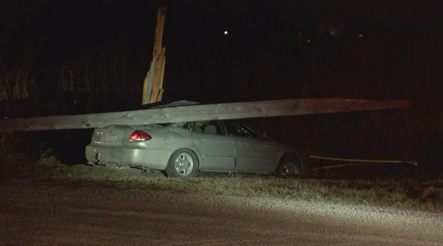 Power pole on top of car