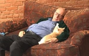 Terry Lauerman volunteers a Safe Haven Pet Sanctuary in Green Bay and regularly naps with pets. Photo via Facebook.