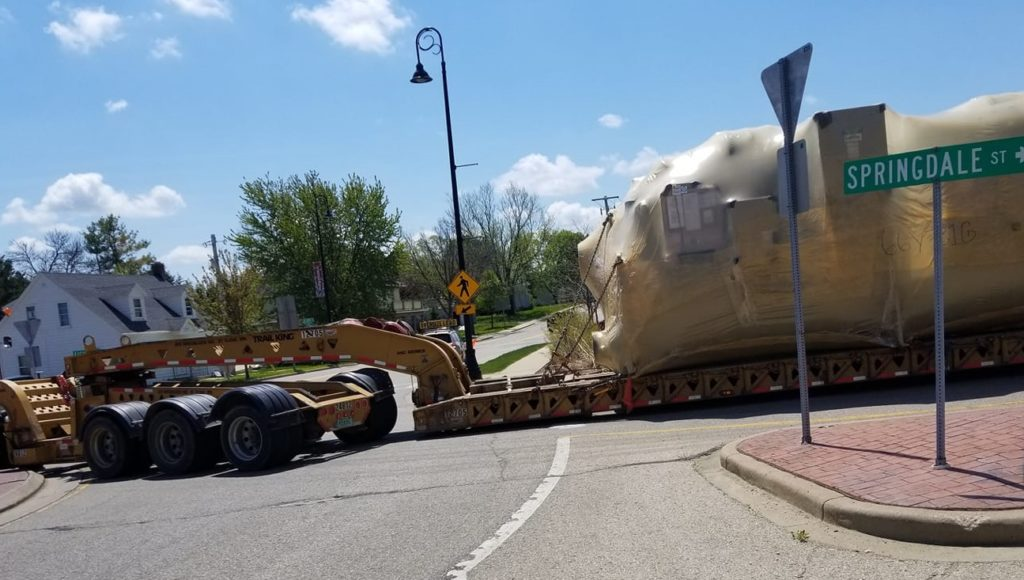 TRAFFIC ALERT: Tractor-trailer Rig Stuck In Roundabout In