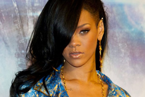 Rihanna shaves half of her head and goes back to black.