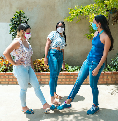 People greeting with foots. Covid 19. Coronavirus prevention. Non-contact greeting. Foot shake style of greetings. Coronavirus epidemic. (People greeting with foots. Covid 19. Coronavirus prevention. Non-contact greeting. Foot shake style of greetings