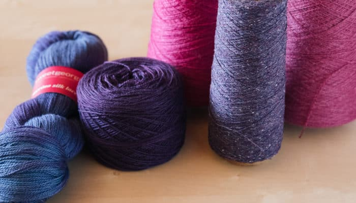 Yarn in a variety of formats — skeins, cakes, balls, cones
