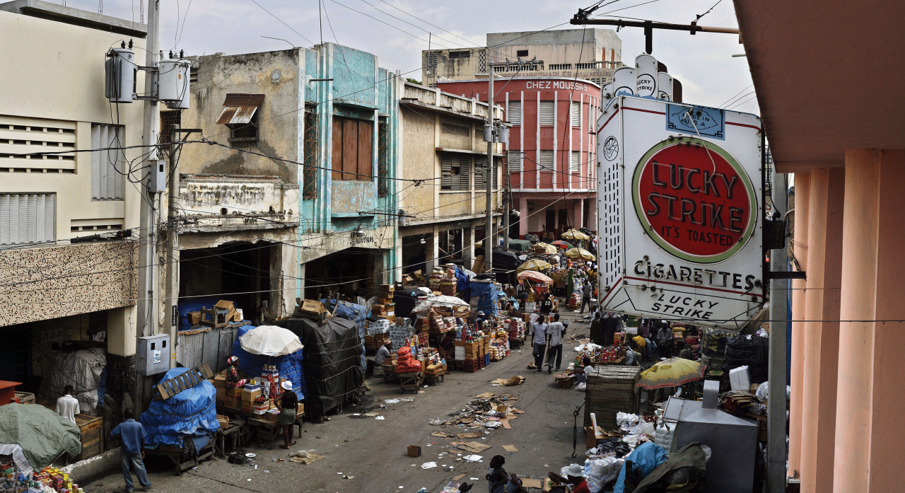 Roger LeMoyne, La République de Port-au-Prince: Lucky Strike, December 2005, Archival giclée print on lustre paper, 24 × 46. Courtesy of the artist.
