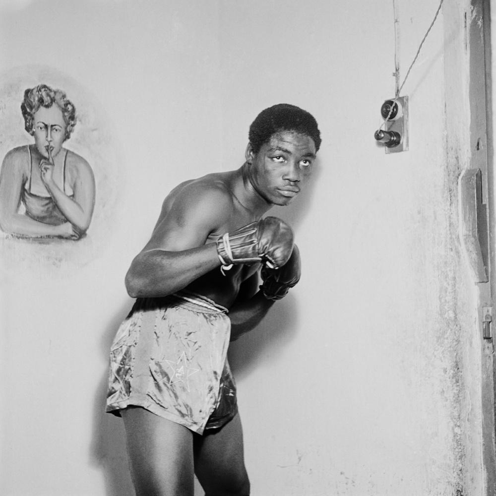James Barnor, Ginger Nyarku Featherweight boxer with Coronation Belt, Accra, 1953. Gelatin silver print, 30 x 30