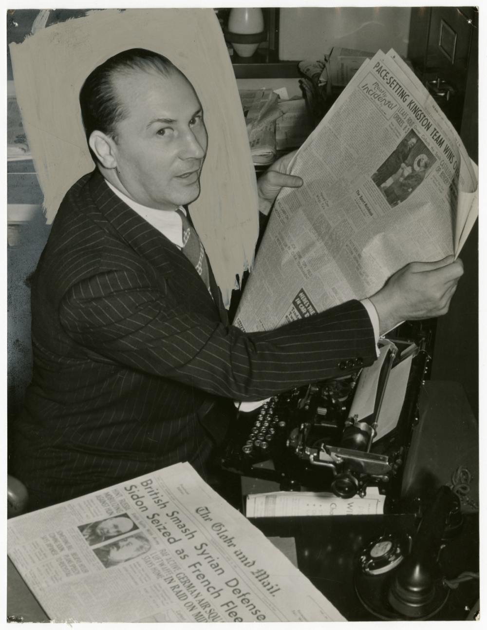 Unidentified photographer, Boxing great Benny Leonard reading The Globe and Mail sports section, c. 1945. Gelatin silver print, 9 × 6.5