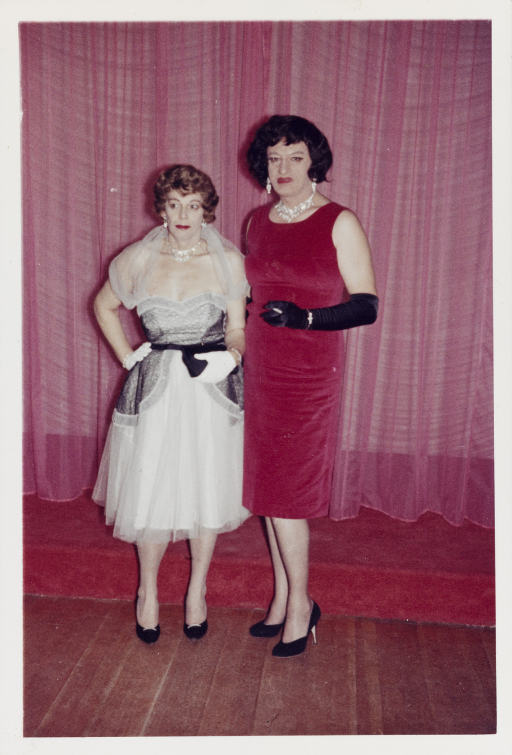 Unknown American, Anita and Gloria Standing by the Stage, October 1961. Chromogenic Print, 12.1 x 8.3 cm. Collection of the Art Gallery of Ontario. Purchase, with funds generously donated by Martha LA McCain, 2015. © Art Gallery of Ontario