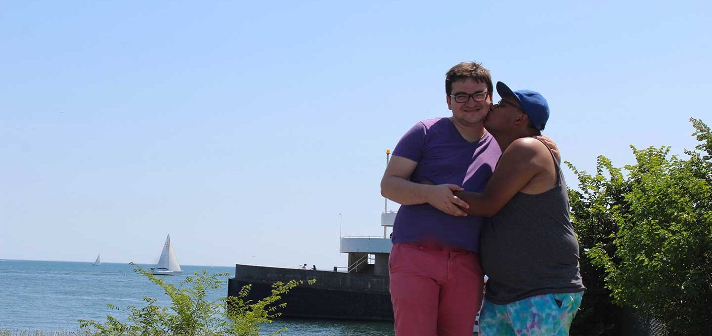 Juan kissing his boyfriend