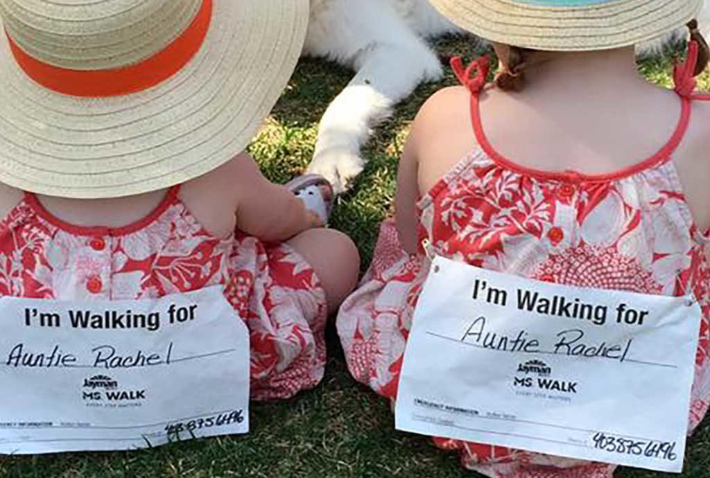 "Rachel's nieces wearing pins that say ""I'm walking for Auntie Rachel."""
