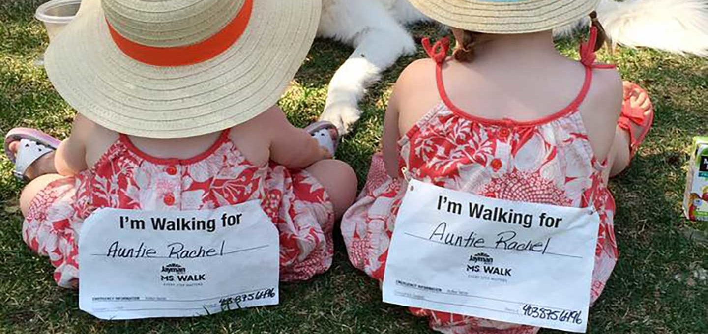 "Rachel's nieces wearing pins that say ""I'm walking for Auntie Rachel."""