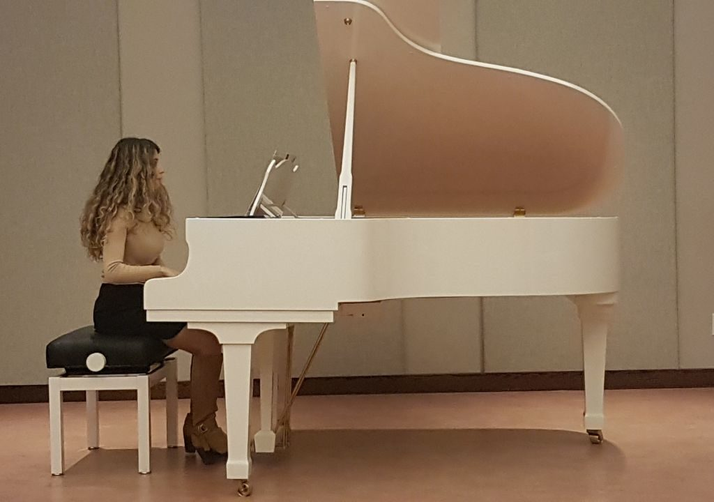 Sogol playing the piano