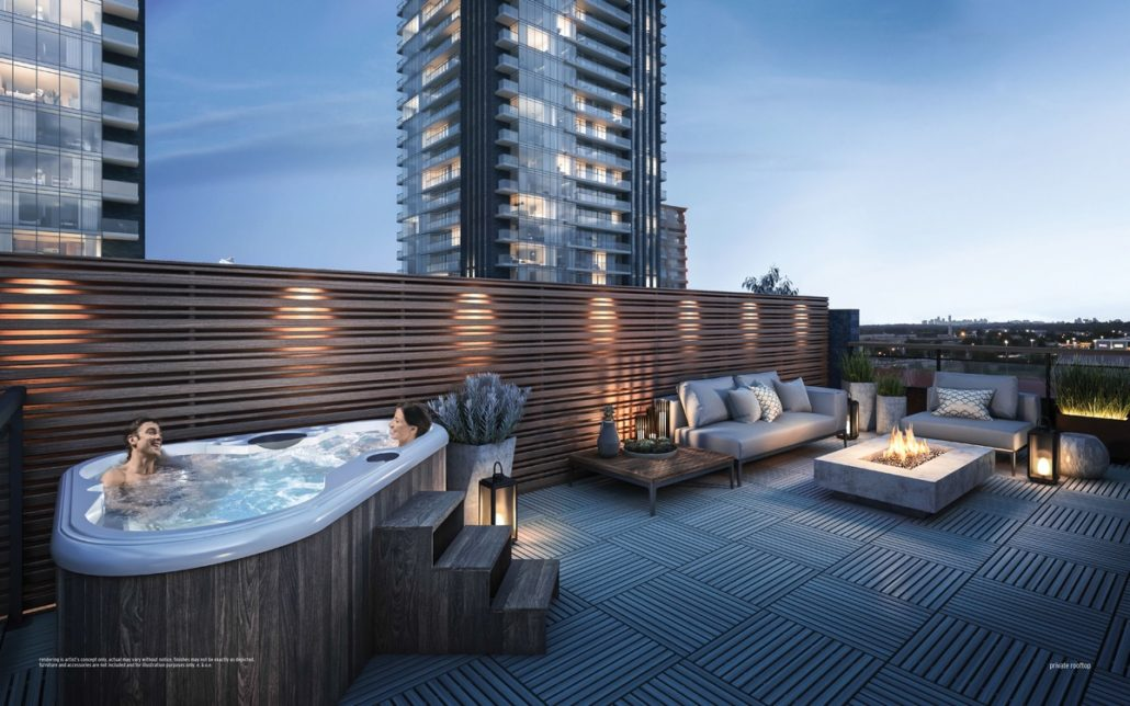 rooftop with hot tub and fire table at ultrasonic condos overlooking two condo buildings
