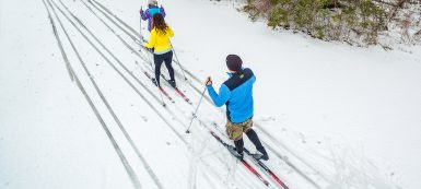 family cross country skiing on trail at Albion Hills Conservation Park