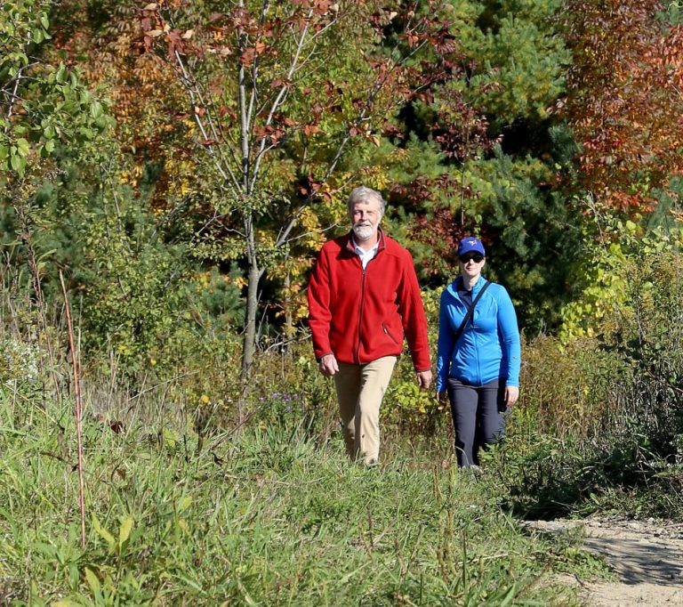 man and woman hike a trail at East Duffins Headwaters