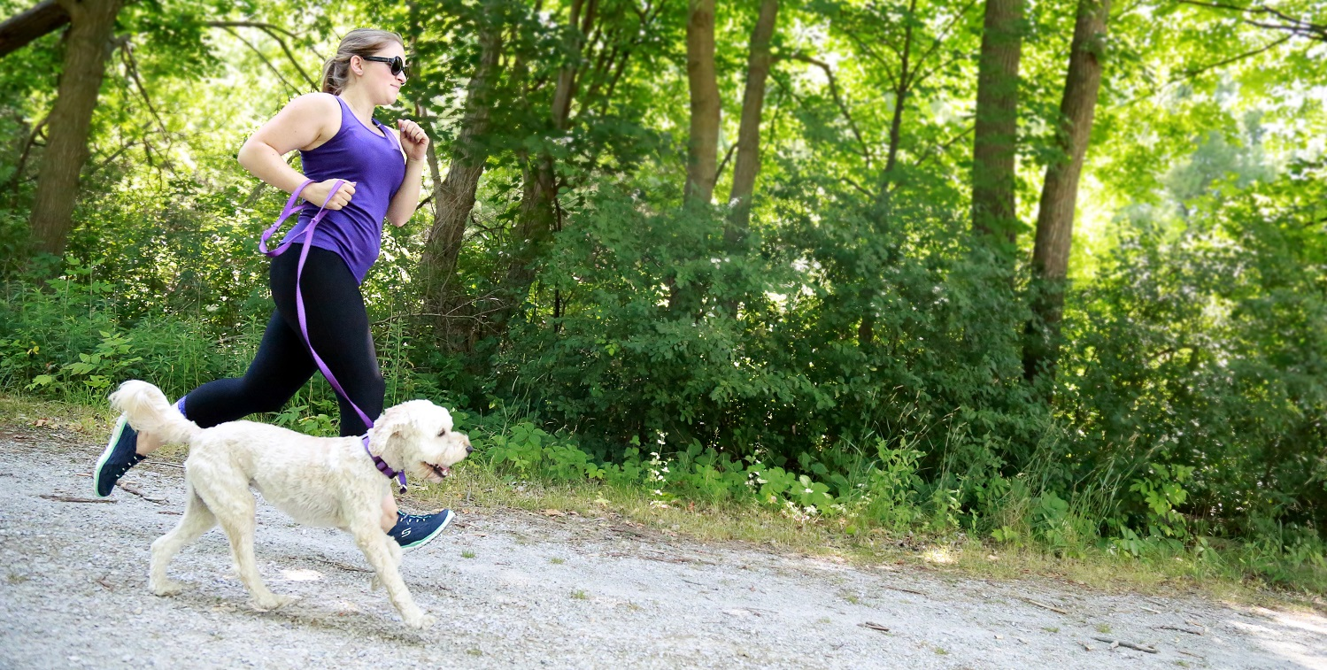 Woman dog walking at Boyd Conservation Area