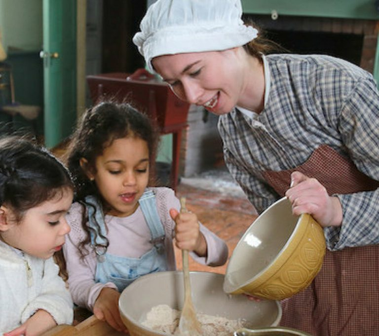 history actor demonstrates baking technique at Black Creek Pioneer Village